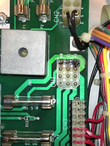 Burned connector, CN1, on the power supply board.