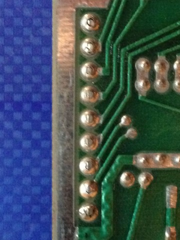 Cracked solder joints on connector pins.